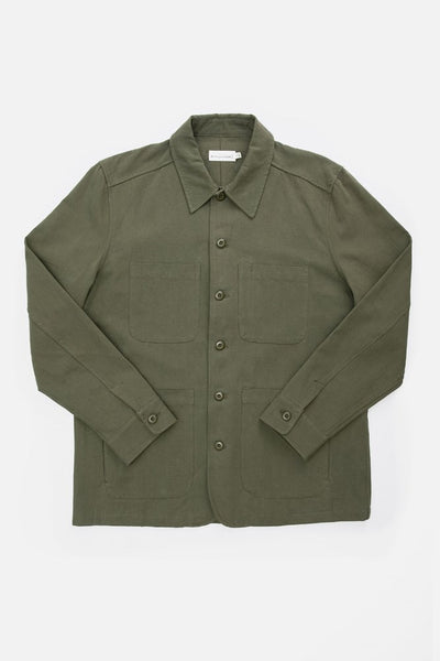 Olive unlined chore coat with chest pockets and dual-entry hand pockets