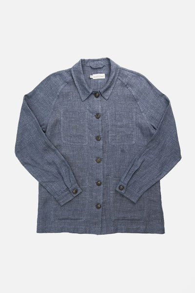 Blue linen workwear chore coat with raglan sleeves and four patch pockets