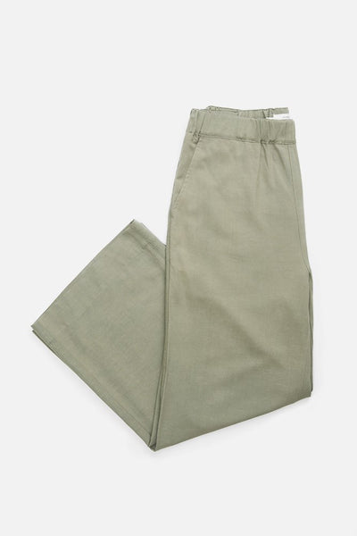 Sage green trouser style pant with a wide elastic waist, relaxed silhouette, and ankle grazing length