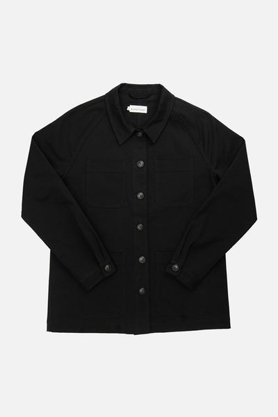 Black workwear chore coat with raglan sleeves and four patch pockets