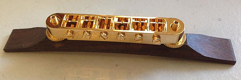 Gold Tunematic bridge on wood base