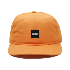 "KICKS/HI <BR> ""K/HI BOX"" LOGO UNSTRUCTURED 6-PANEL CAP (ORANGE MICRO RIPSTOP)"