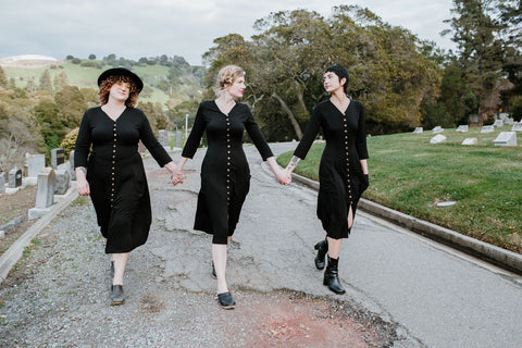 women wearing the fiona dress walking thought the cemetery