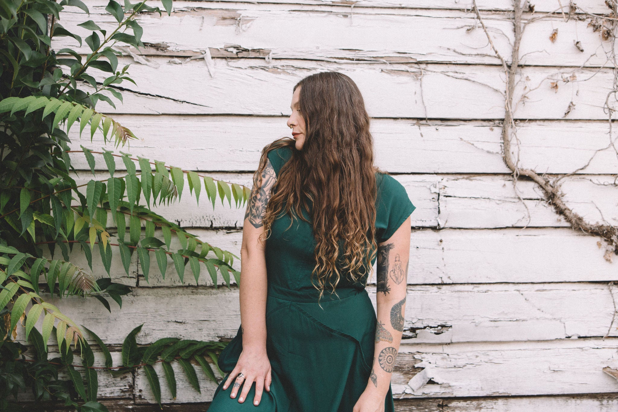 emerald green xena dress on a white woman with long hair