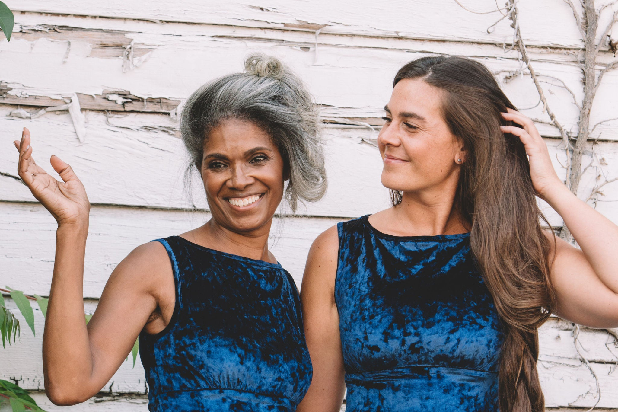 Blue velvet dress worn by a older black woman and a younger white woman