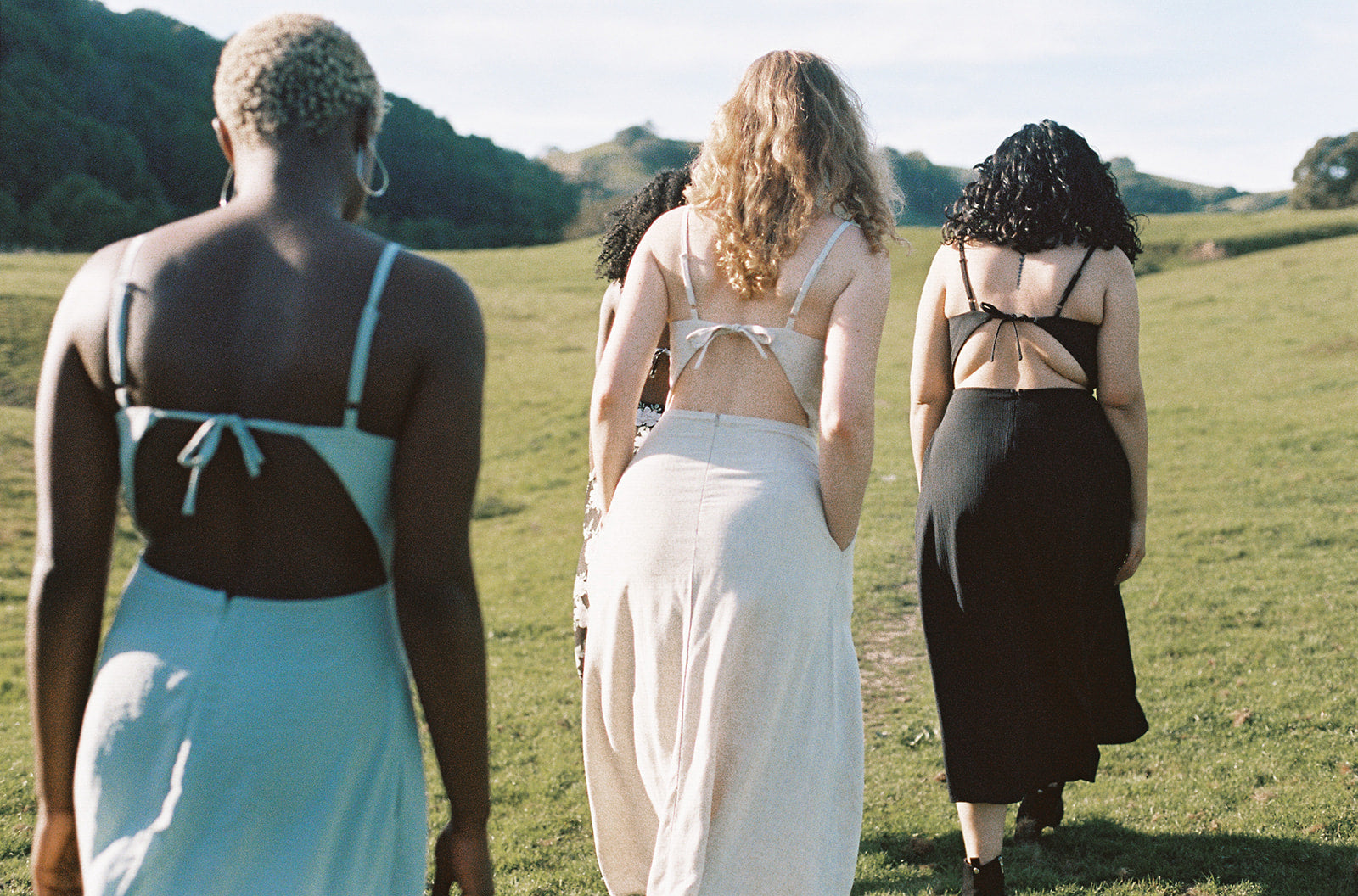 Field Day open back dresses on women walking up a hill