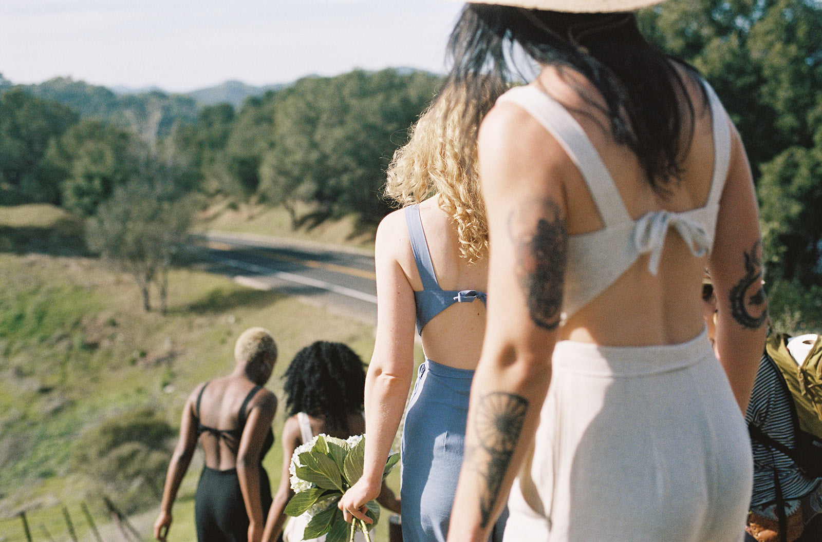 jumpsuit with open back on women walking down a hill