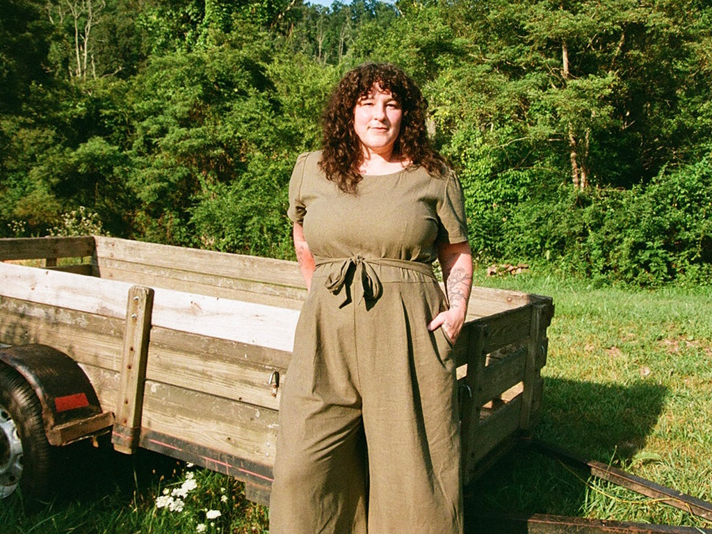 emily of whiskey dog wears in a olive linen vega jumpsuit