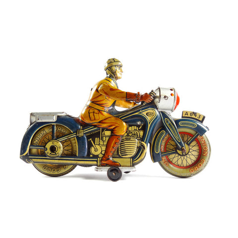CKAO clockwork motorcycle and civilian rider c.1930s
