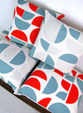 Radius Cushion: Red, Teal