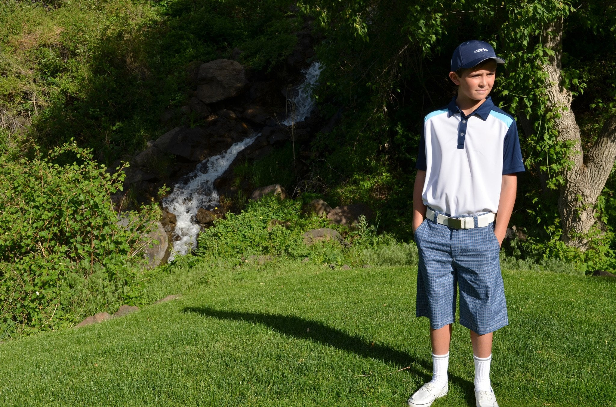 Junior golfer wearing the Garb hybrid golf shorts