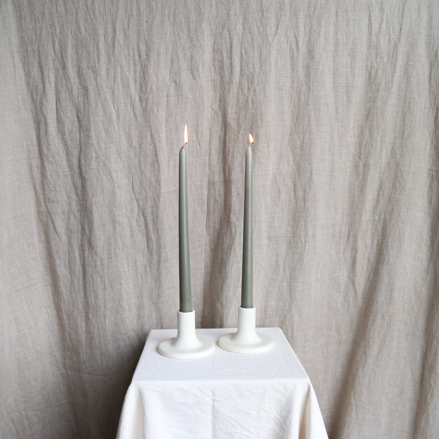 Pair of moss taper candles in white holders available at Rook & Rose.