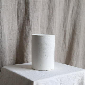 Short white ceramic vase available at Rook & Rose
