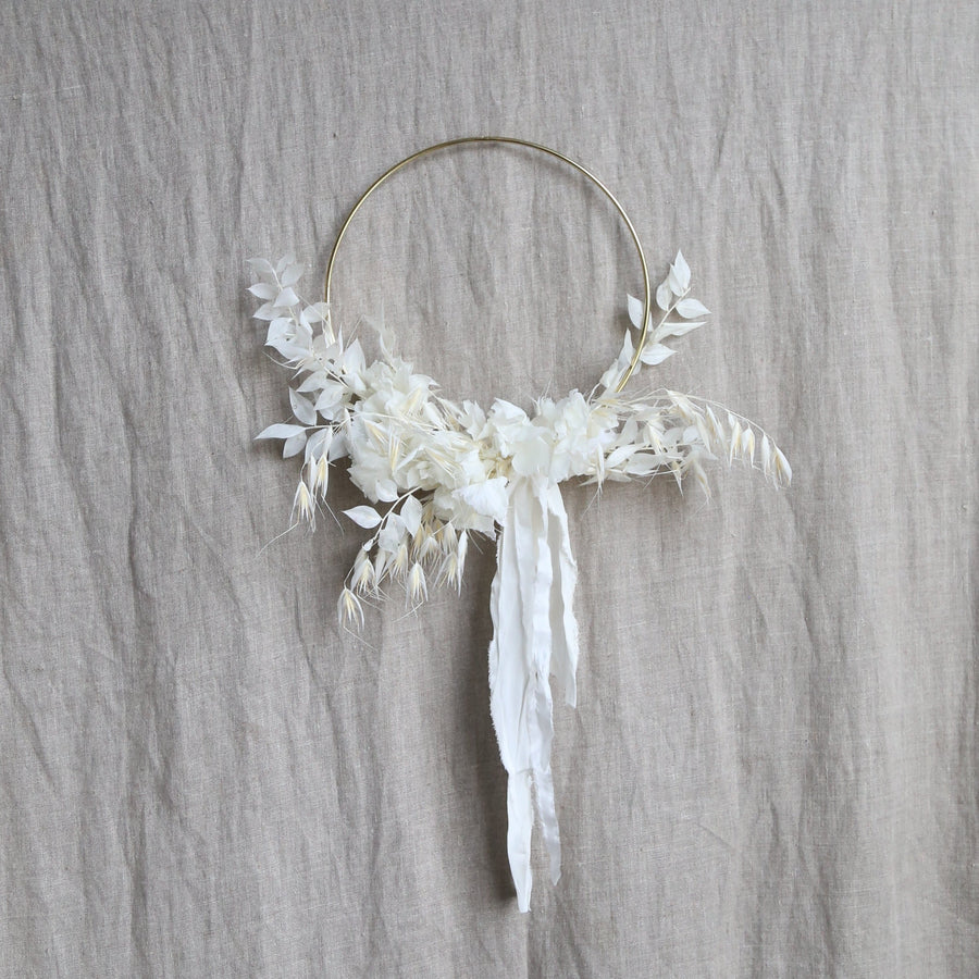 Crescent white dried floral wreath with gold hoop available at Rook & Rose.
