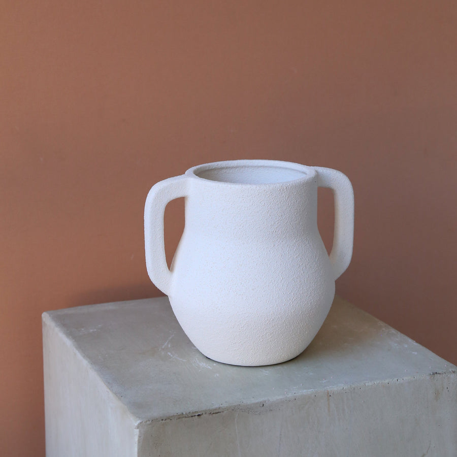 Textured white vase with two handles available at Rook & Rose