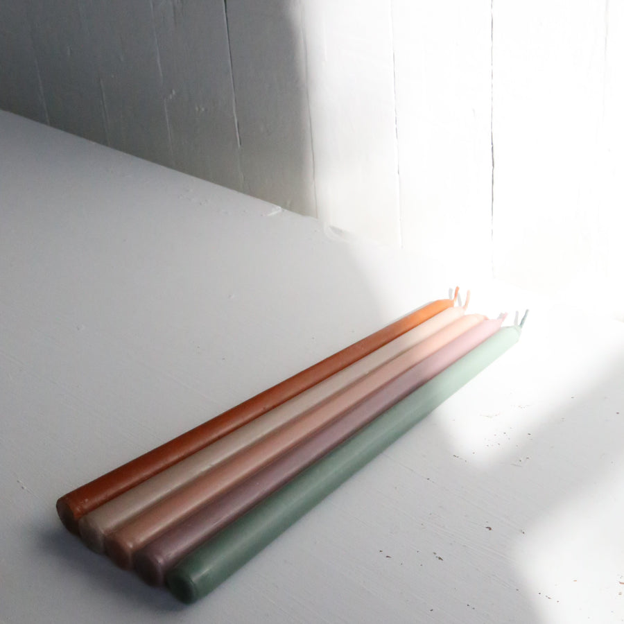Red clay taper candles available at Rook & Rose in Victoria, BC