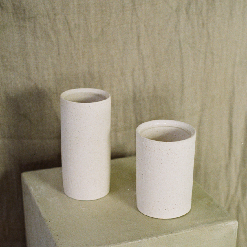 Pair of white ceramic vases available at Rook & Rose