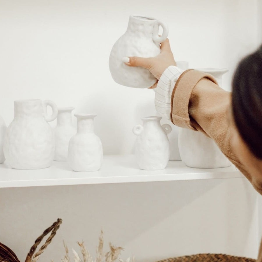 Small white textured ceramic bottle vase available at Rook & Rose