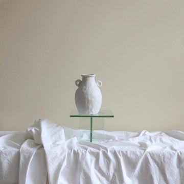White textured ceramic urn available at Rook & Rose