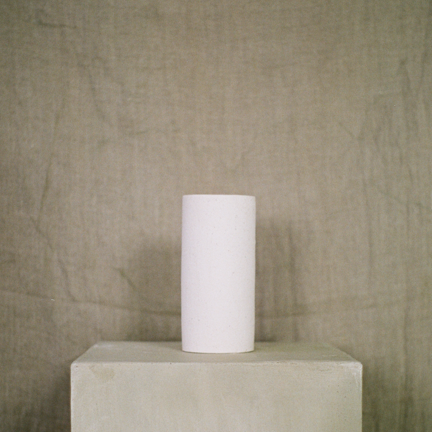 Tall white ceramic vase available at Rook & Rose