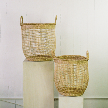 Two 15 inch woven jute baskets available at Rook & Rose