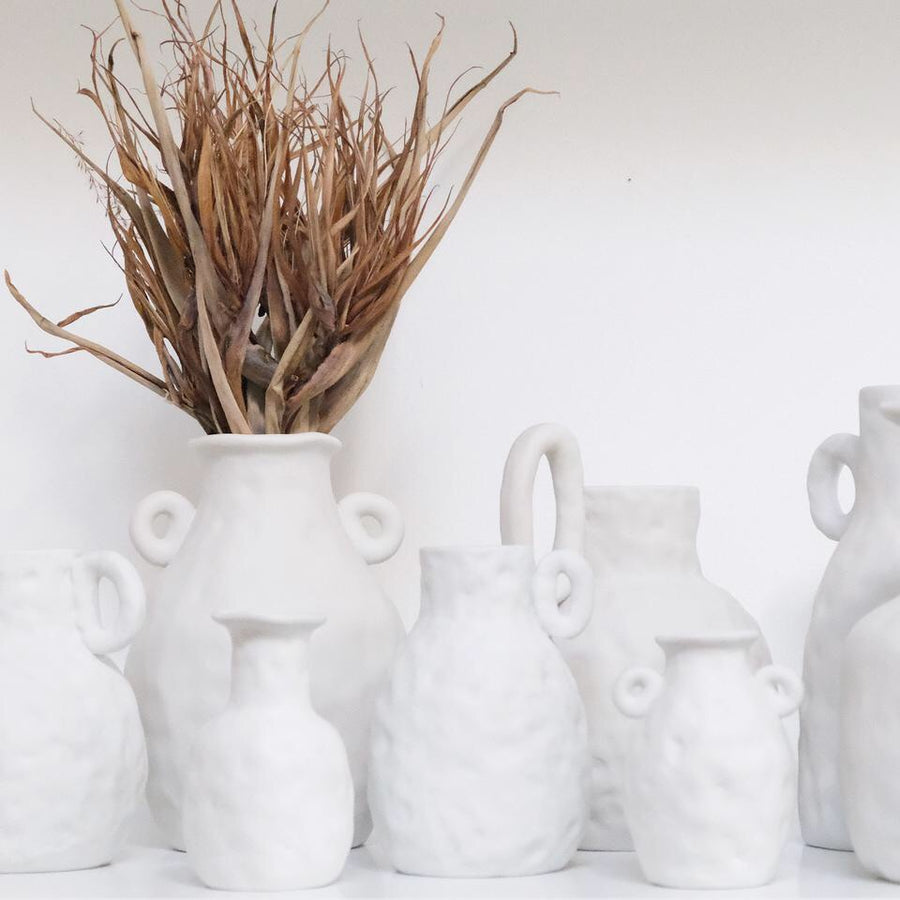 White textured ceramic bottle jar available at Rook & Rose
