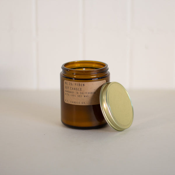 Pine scented candle in an amber glass container by P.F. Candle Co. available at Rook & Rose in Victoria, British Columbia, Canada
