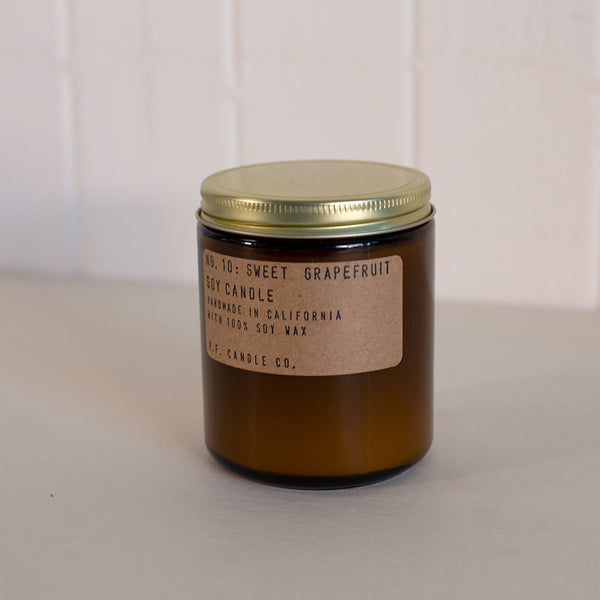 Grapefruit scented candle in an amber glass container by P.F. Candle Co. available at Rook & Rose in Victoria, British Columbia, Canada