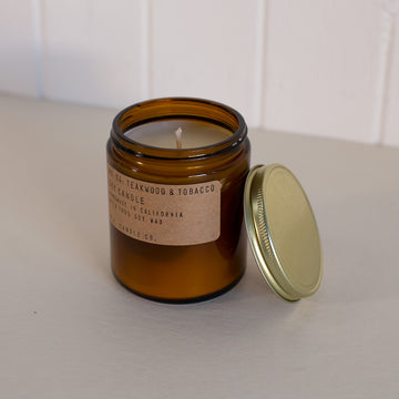 Woodsy scented candle in an amber glass container by P.F. Candle Co. available at Rook & Rose in Victoria, British Columbia, Canada