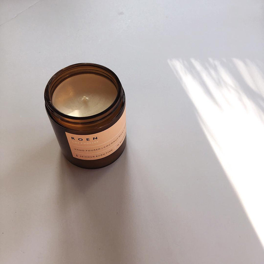 Sandalwood scented candle in an amber glass container by ROEN available at Rook & Rose in Victoria, British Columbia, Canada