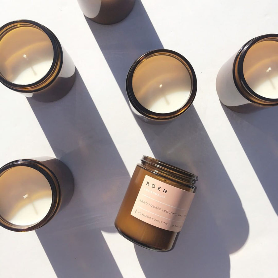 Fir and fig scented candle in an amber glass container by ROEN available at Rook & Rose in Victoria, British Columbia, Canada