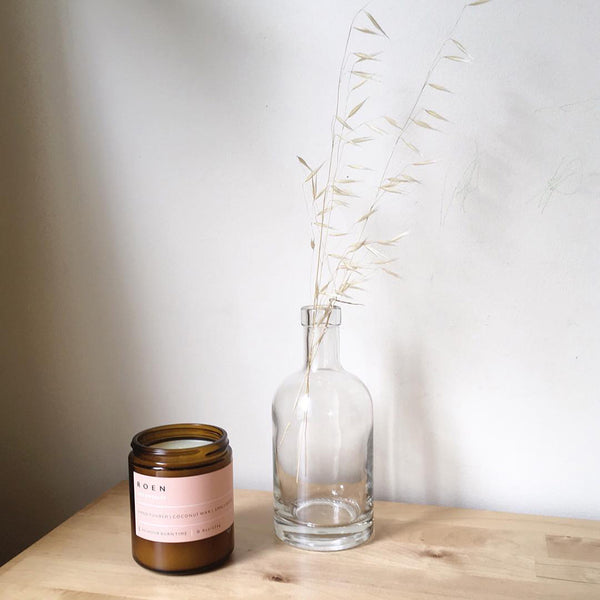 Ginger scented candle in an amber glass container by ROEN available at Rook & Rose in Victoria, British Columbia, Canada