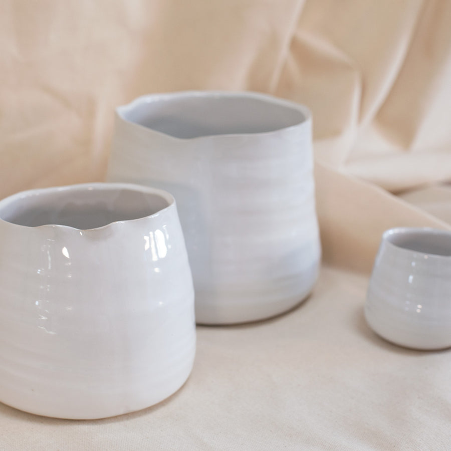 White asymmetrical ceramic vase available at Rook & Rose in Victoria, British Columbia, Canada