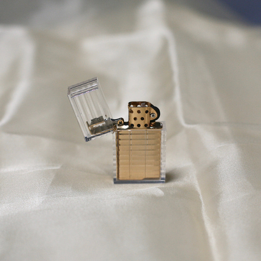 Gold Tsubota Pearl hard edge lighter available at Rook & Rose