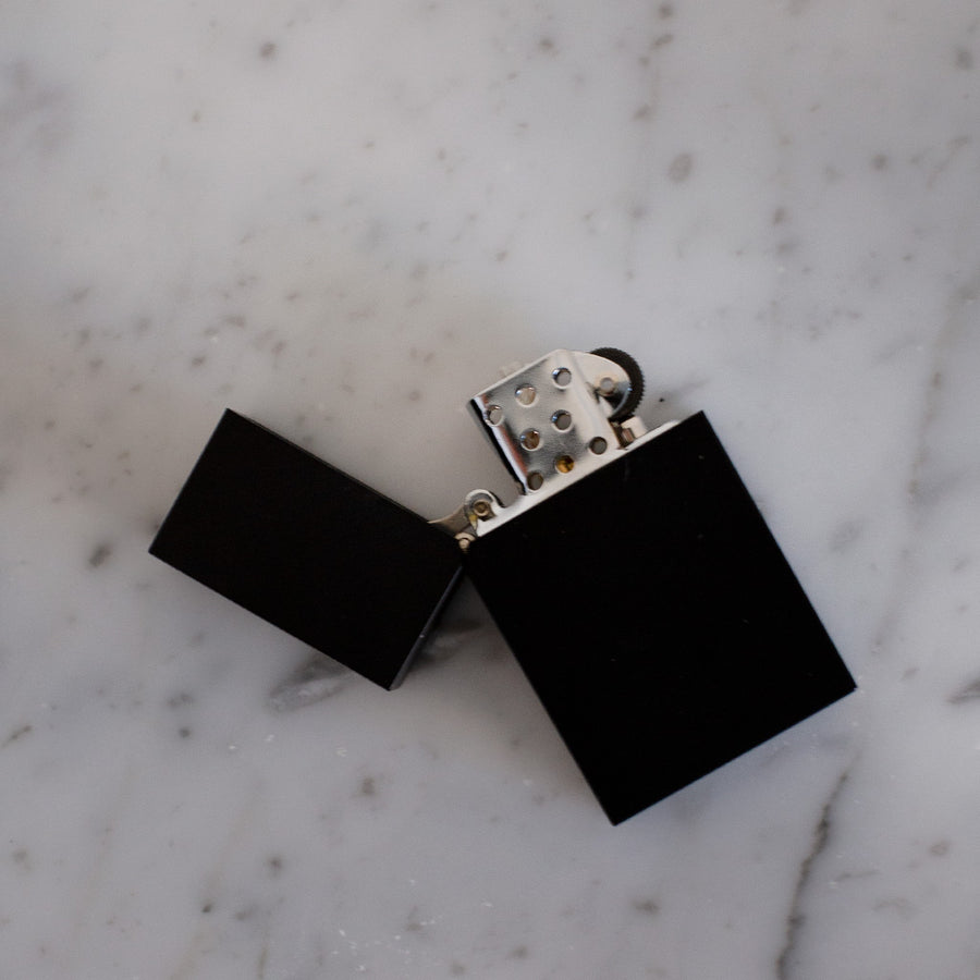Black Tsubota Pearl hard edge lighter available at Rook & Rose