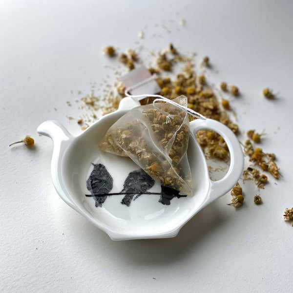 TEA BAG TIDY: STARLING design on a bone china tea bag tidy/filter rest/stand.