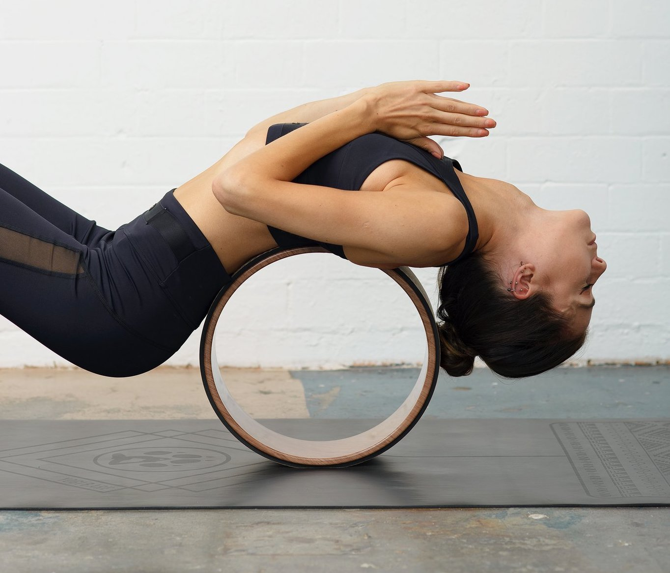5 Ways To Use A Yoga Wheel For Back Pain