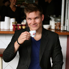 Christian Baker the CEO and Co Founder of Upside Nutrition drinking an espresso