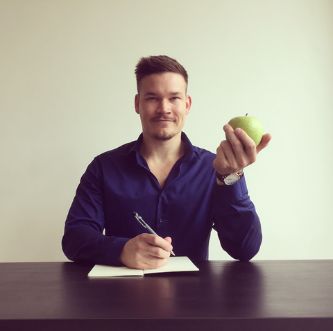 Christian Baker with a green apple in his hand