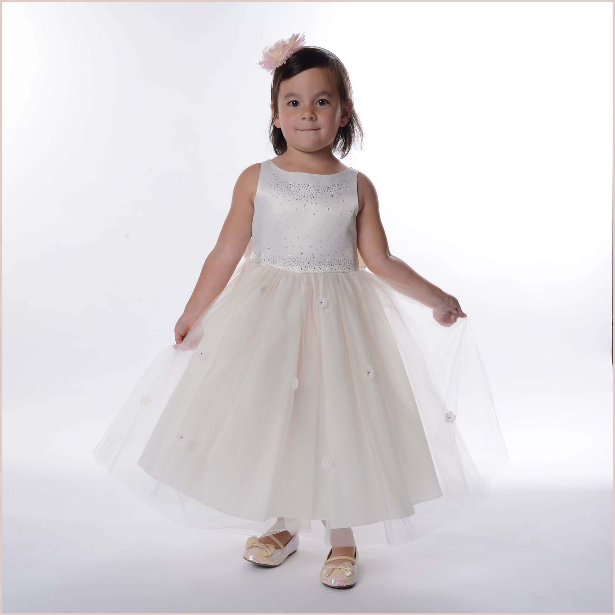 Ivory sparkle bodice flower girl dress with flowers on skirt