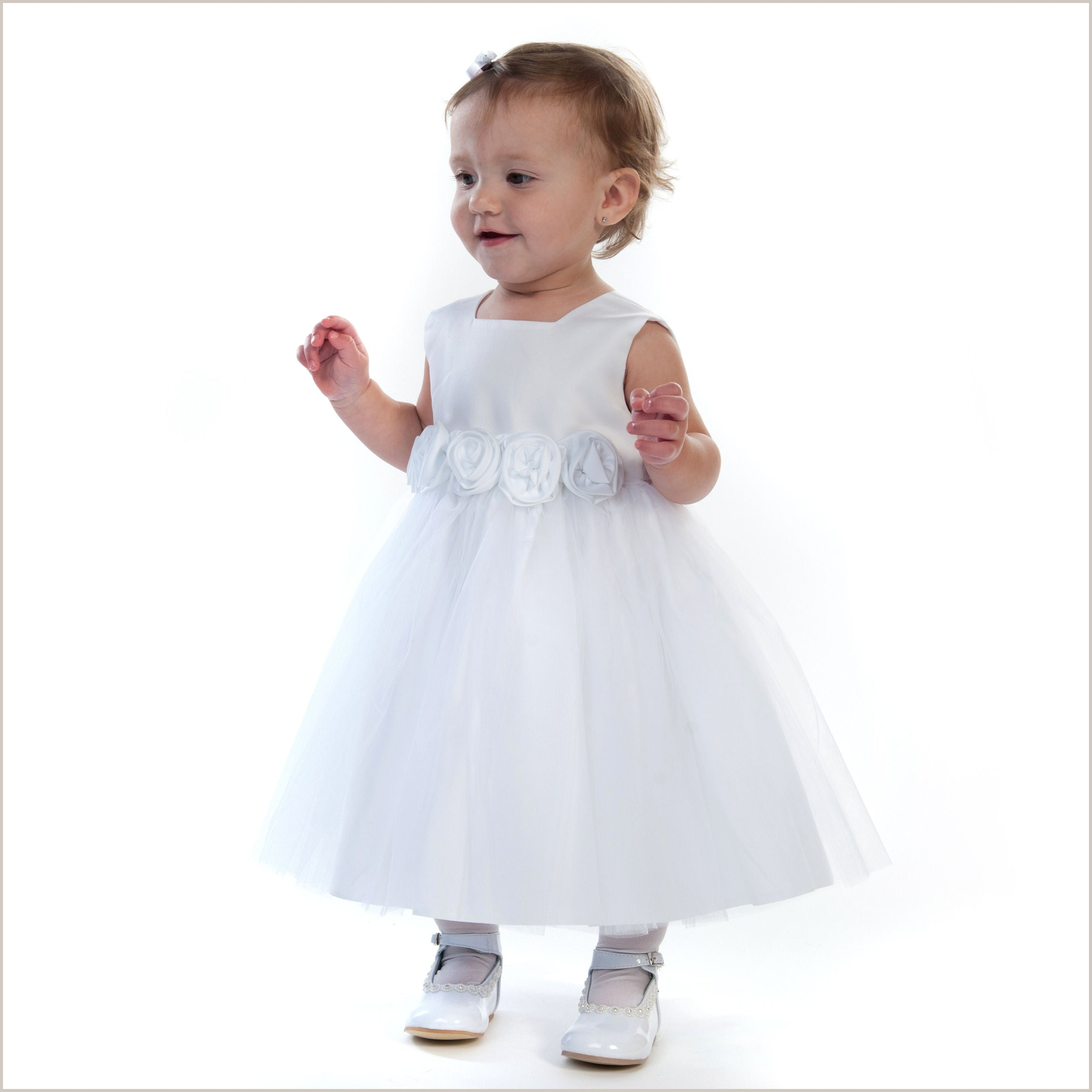 White satin and tulle flower girl dress with rolled roses