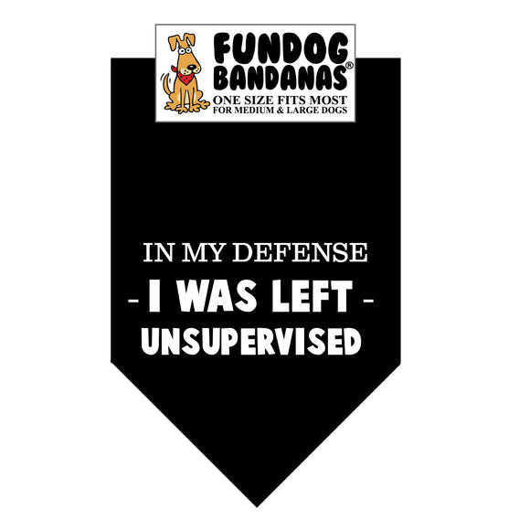 Black one size fits most dog bandana with In My Defense I was Left Unsupervised in white ink.