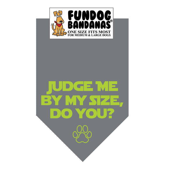 Charcoal Gray one size fits most dog bandana with Judge Me By My Size, Do You and a paw in lime green ink.