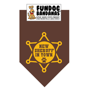 Brown one size fits most dog bandana with New Sheruff in Town and a sheriff's star in gold ink.