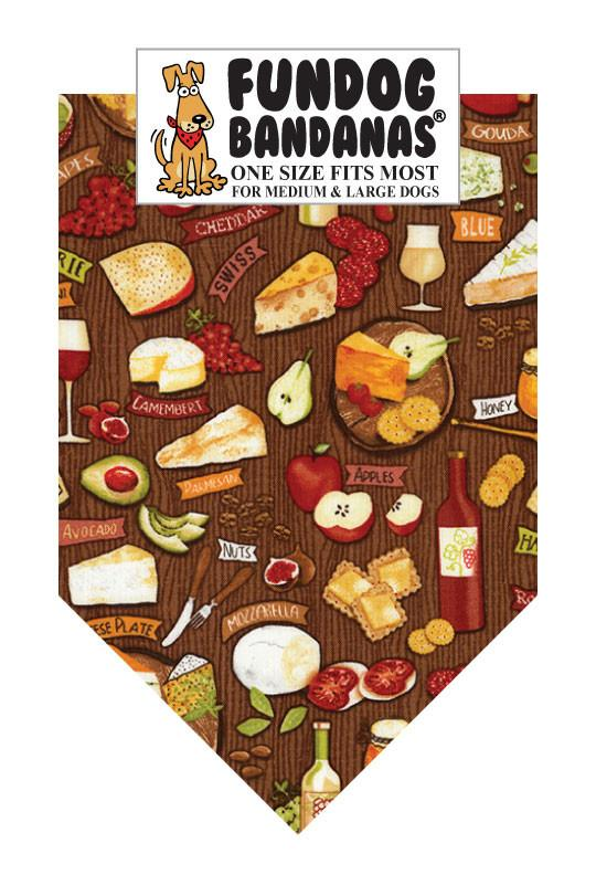 Different wines and cheeses are scattered across a brown one size fits most dog bandana.