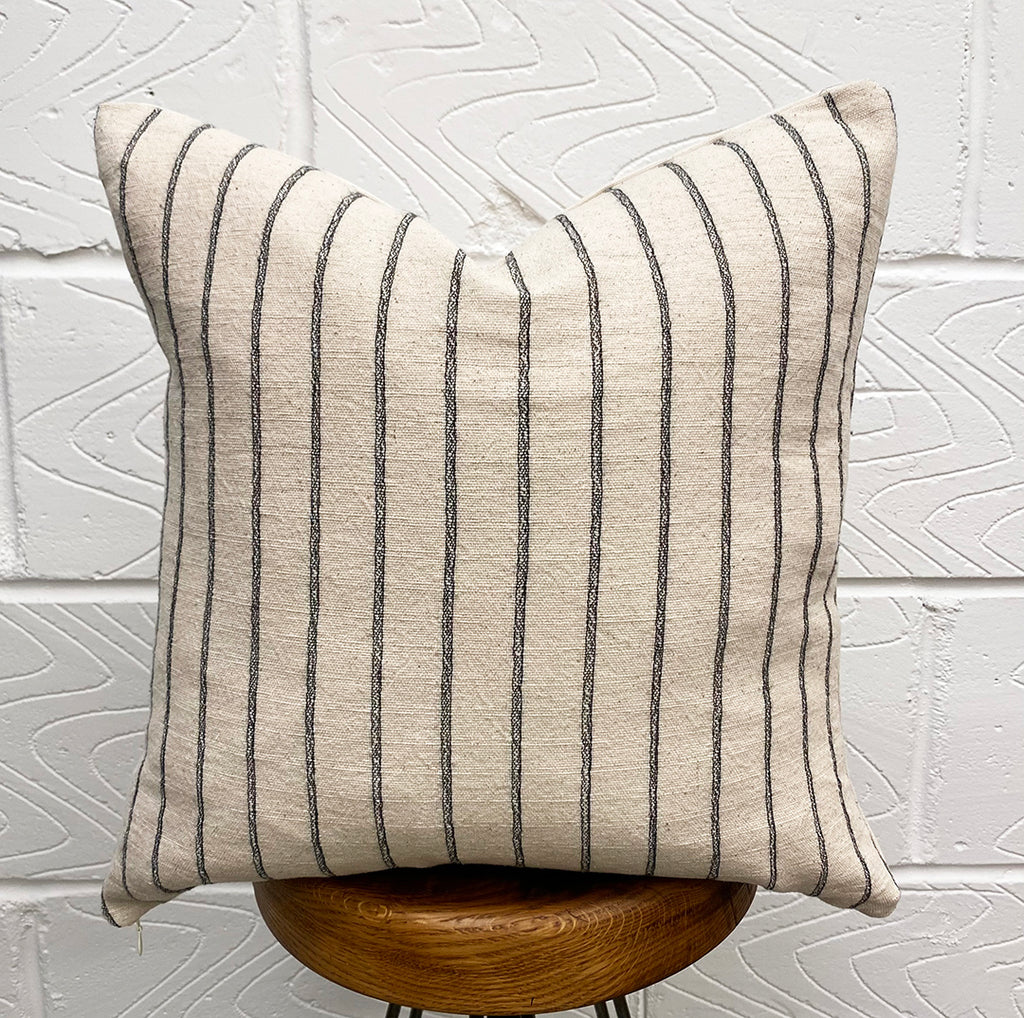 black and cream stripes cushion