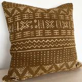 mustard mudcloth cushion
