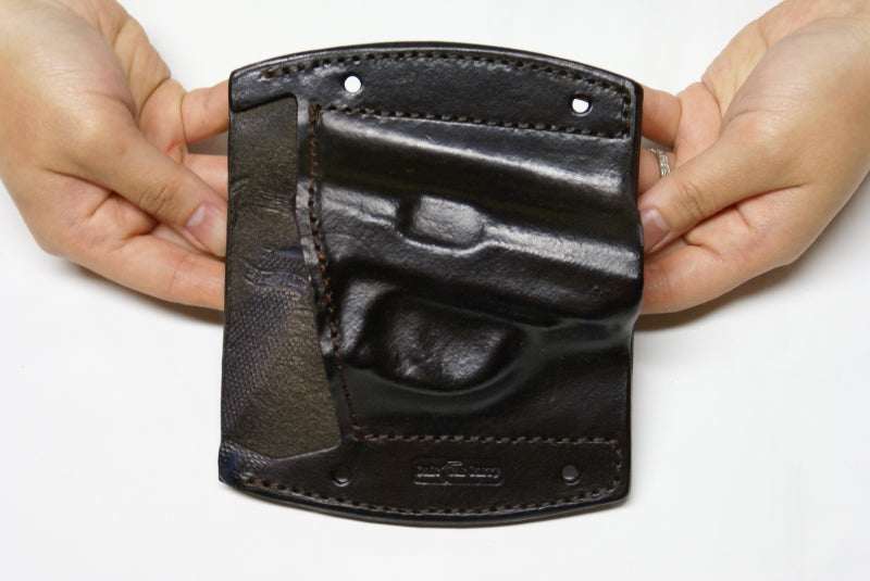 Car mountable holster, now safely keep your gun in your glove box, center console, door panel or under your steering wheel