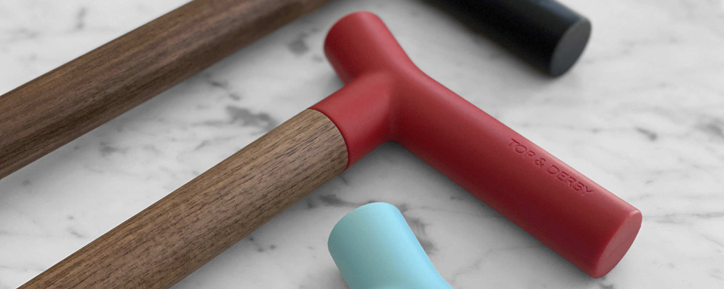 red, blue and black silicone cane handles on marble table