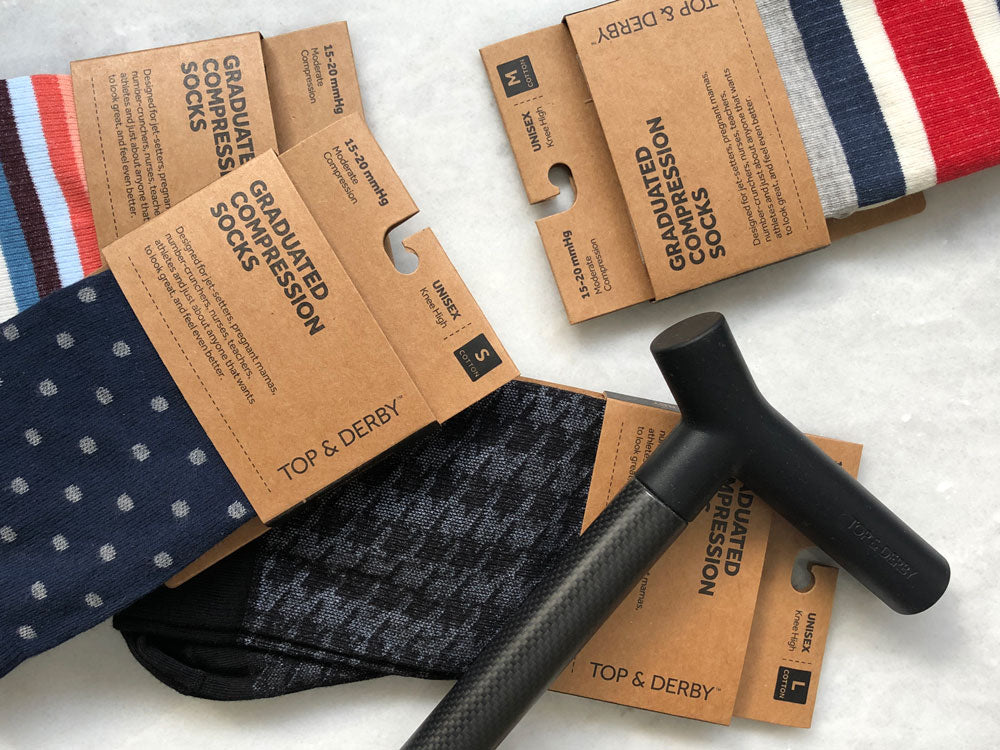 sock packages and cane on marble background